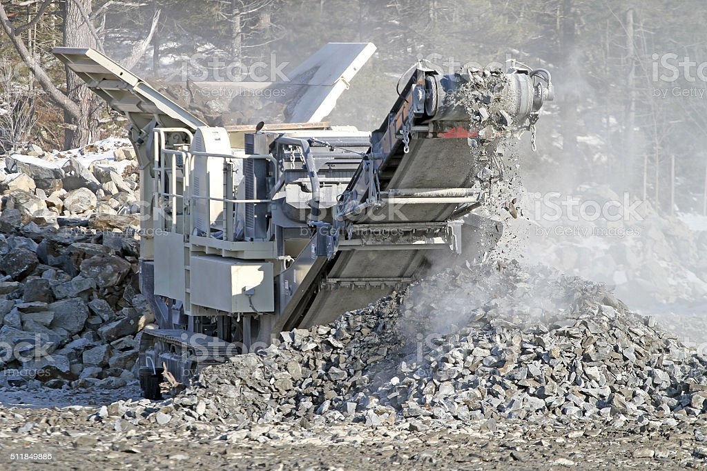 Rock Crusher In Action On New Road Construction Site stock photo