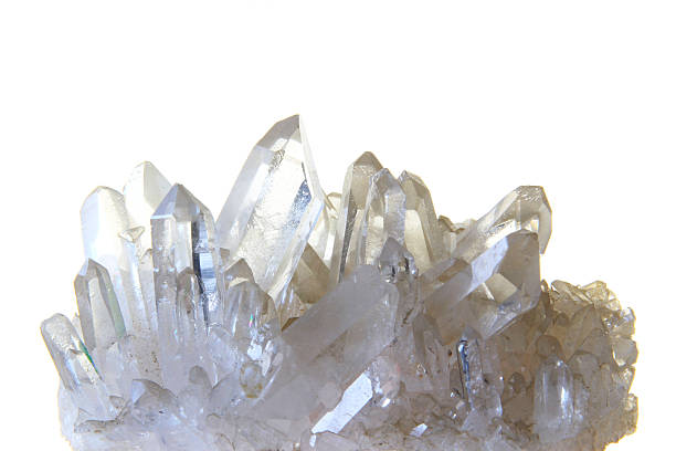 Rock crystal Rock crystal with many single crystals in front of white background quartz stock pictures, royalty-free photos & images