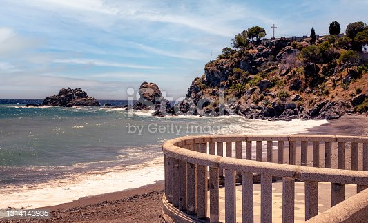 Rock de San Cristobal at Almunecar, Southern Spain. A Christian cross is standing on the top of the rock which offers a great view of the coastline towards west as well as east