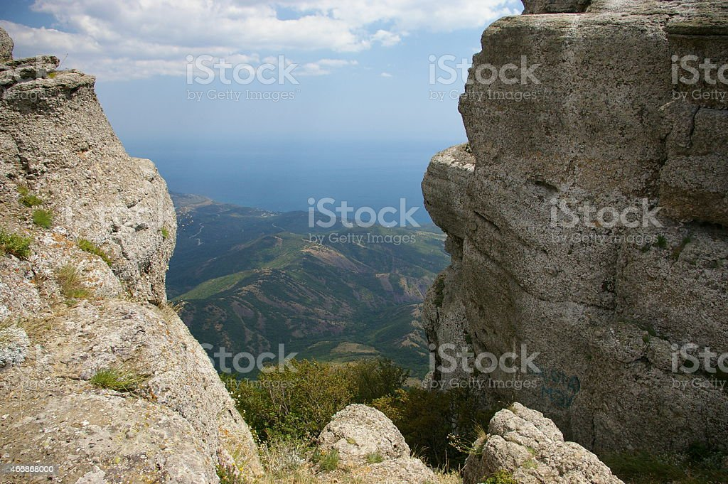 Rock 'Demerdji'. Scenic landscape with rocks and clouds stock photo