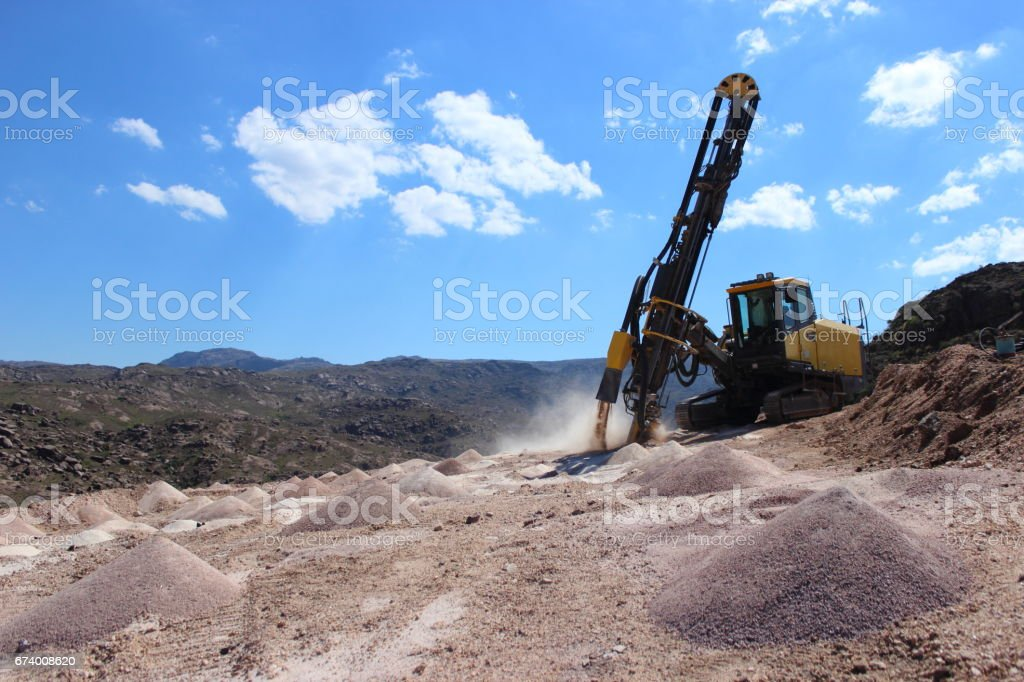 rock drilling machine stock photo