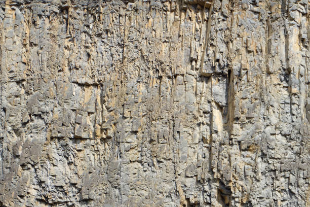 rock face / cliff at a quarry - irregular stone pattern stock photo