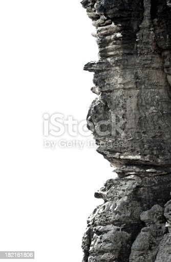 Rock face isolated on white (weathered  sandstone in Saxon Switzerland).