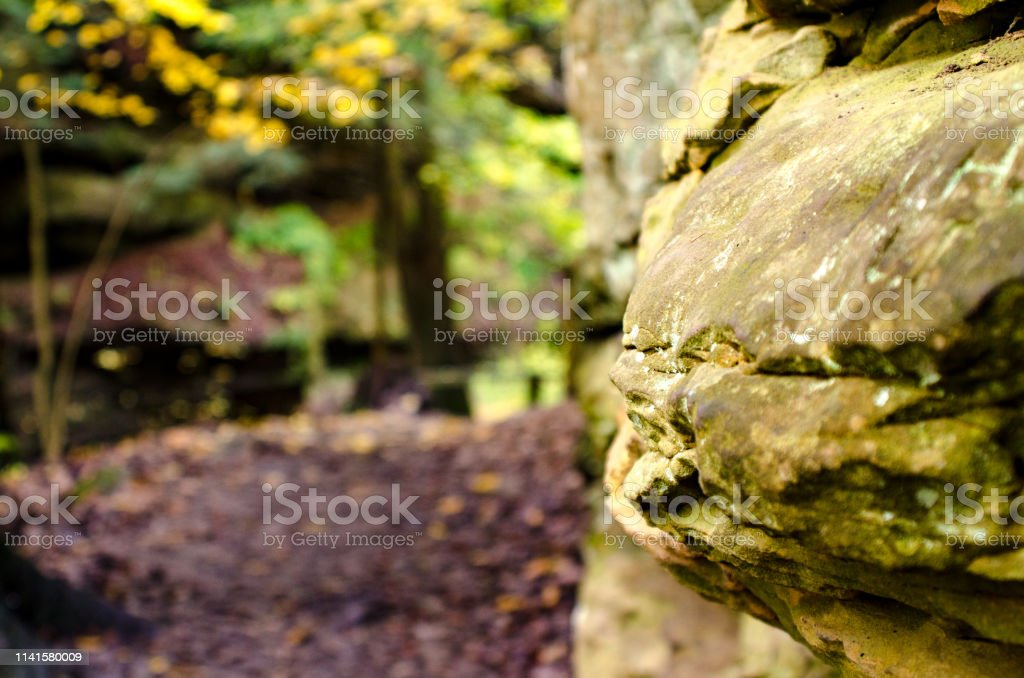 A rock formation along a hiking trail stock photo
