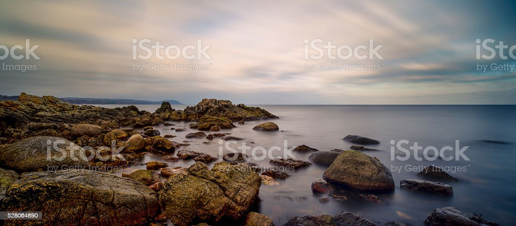 Rock Formation and horizon by the waters edge (XXXLarge) stock photo