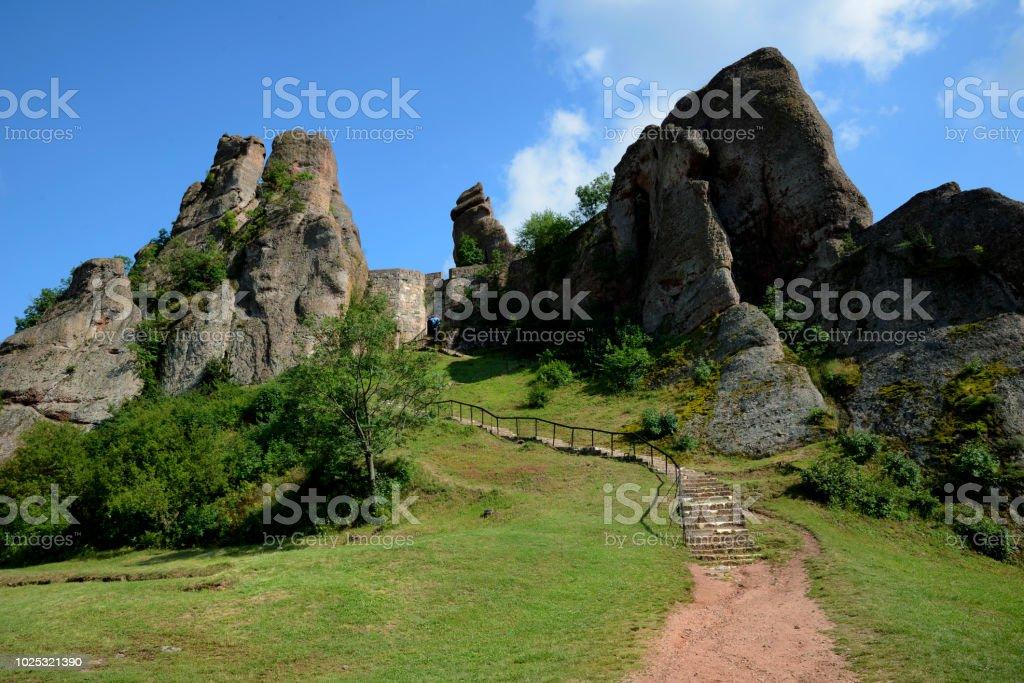Rock formation Belogradchik Rocks and ancient Kaleto Fortress, Bulgaria. stock photo
