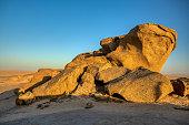 istock Rock formation in Namib desert in sunset, landscape 1281584148