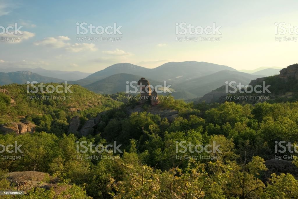 rock formation in the woods around Belogradchik at evening, Bulgaria stock photo
