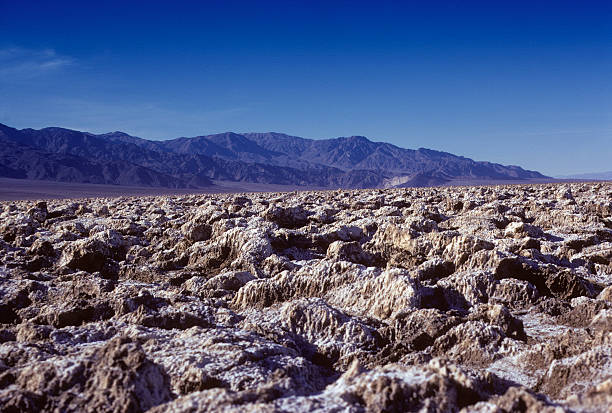 Rock formations in the Death Valley desert Interesting rock formations on the desert floor of Death Valley, California hearkencreative stock pictures, royalty-free photos & images