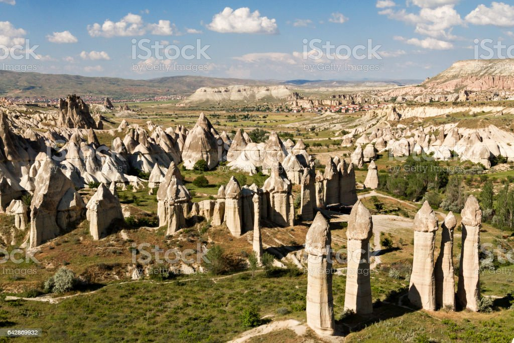Rock formations known as fairy chimneys in the Valley of Love in Cappadocia. stock photo