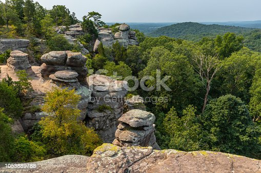 A scenic landscape featuring rock formations.