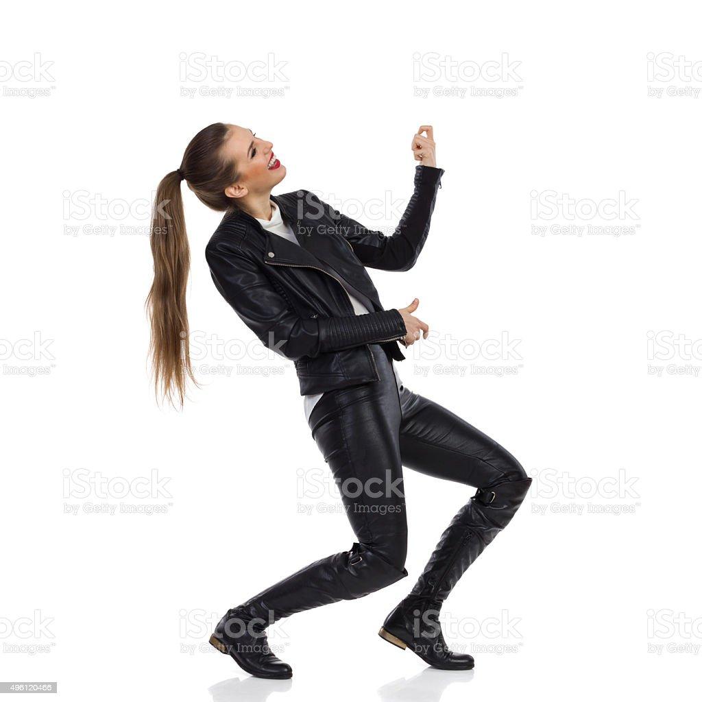 Rock Girl Plays The Air Guitar stock photo