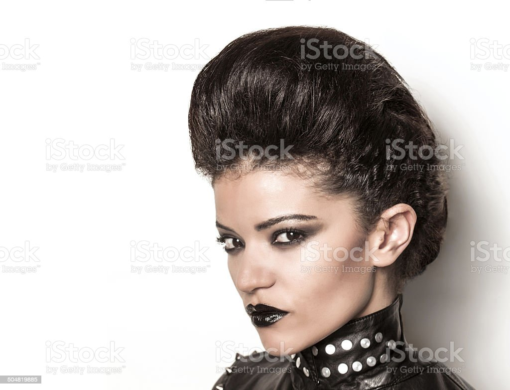 Rock girl with glamour look half profile stock photo