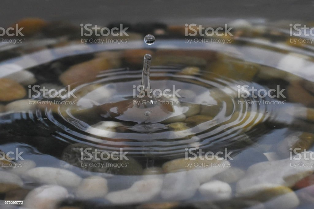 A Rock Hitting the Water stock photo