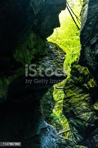 Beautiful Kozjak waterfall hidden in canyon near Kobarid in Slovenia, Triglav National Park.