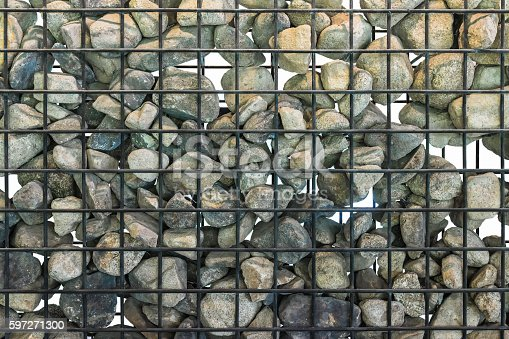 Rock In Cage Stock Photo & More Pictures of Abstract