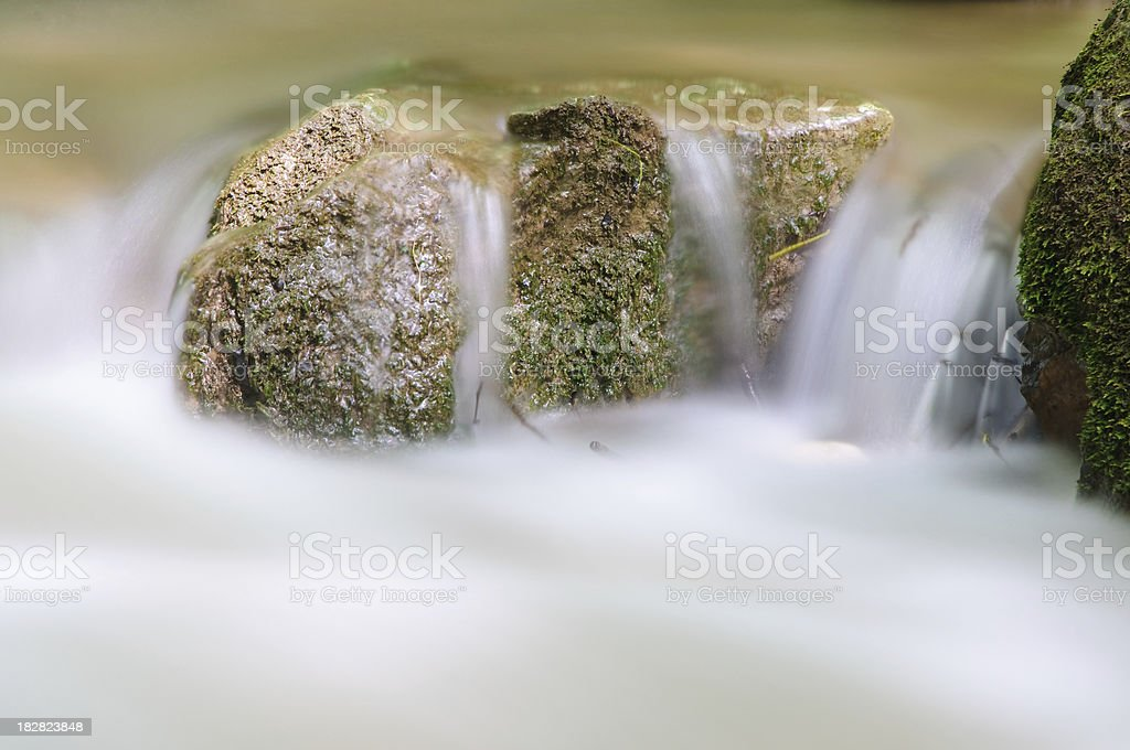 Rock in floating water royalty-free stock photo