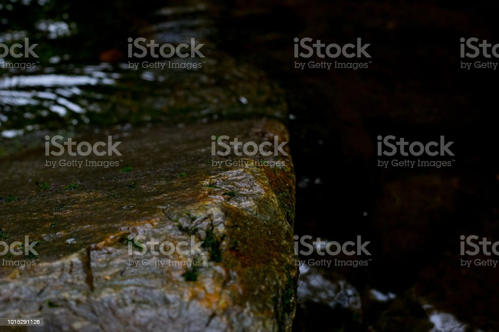 Rock in river stock photo