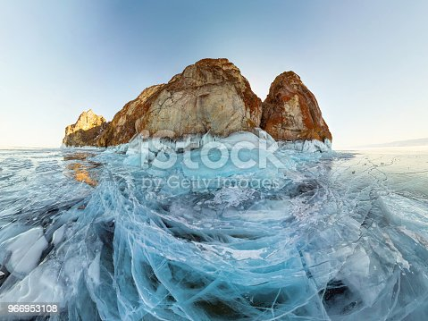 istock rock in the ice of Lake Baikal, the island of Olkhon. Panorama landscape, abstraction 966953108