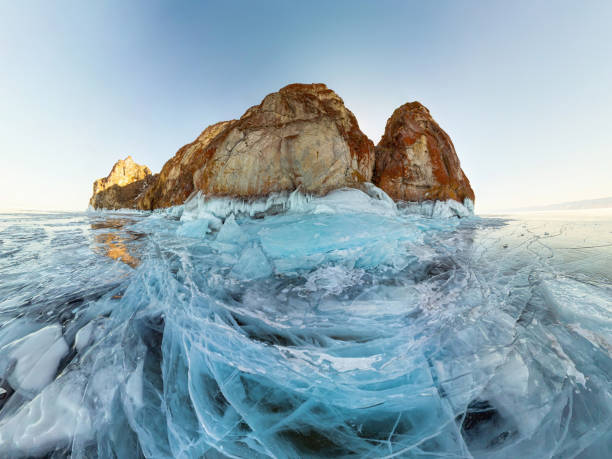 rock in the ice of Lake Baikal, the island of Olkhon. Panorama landscape, abstraction stock photo