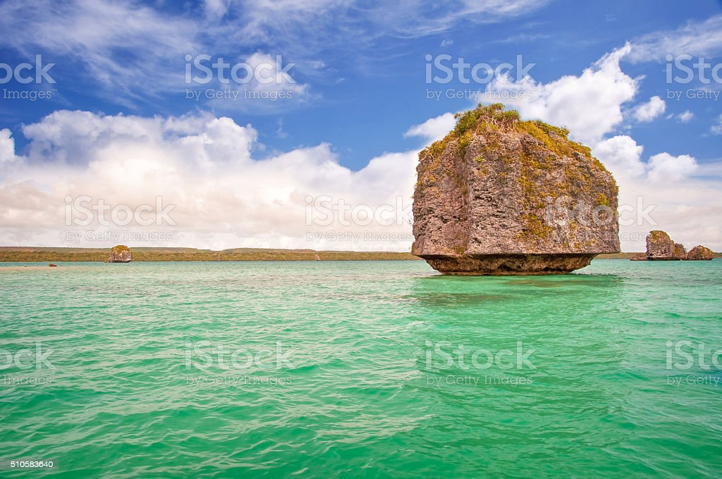 Rock in the water, Isle of Pines, New Caledonia stock photo