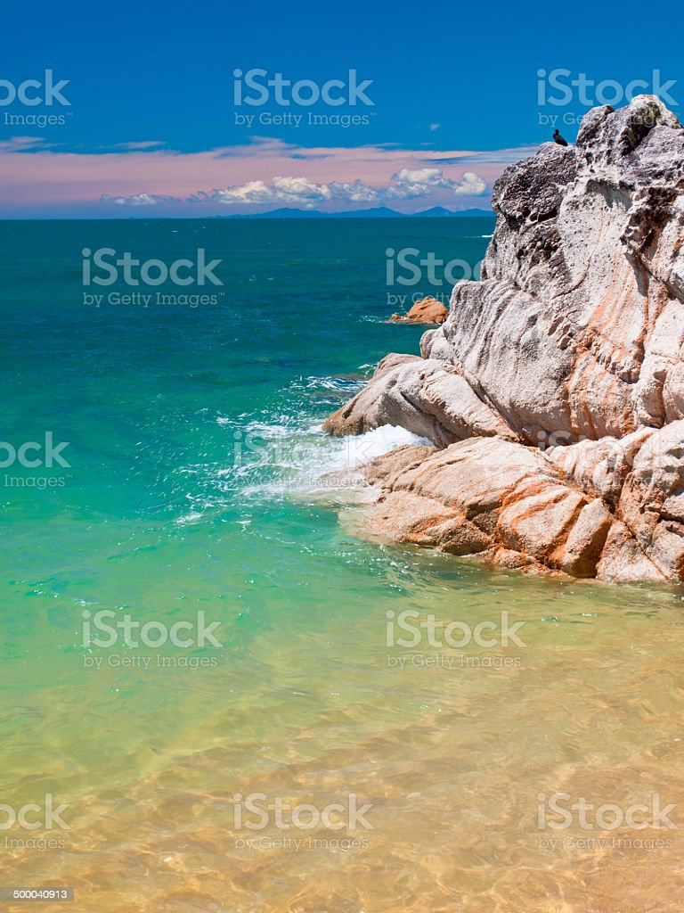 Rock in Turquoise Water stock photo