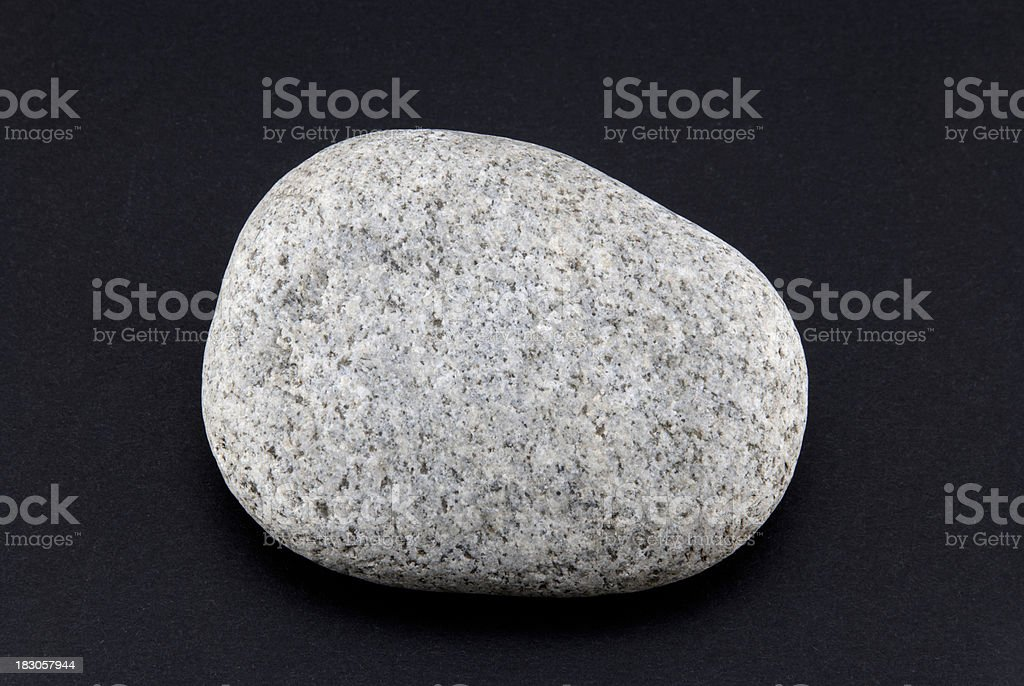 Rock isolated on black stock photo