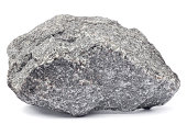 Close-up of a grey rock isolated on white. Focus is front to back.