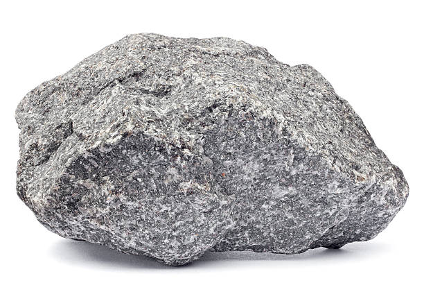 Rock isolated on white Close-up of a grey rock isolated on white. Focus is front to back. rock object stock pictures, royalty-free photos & images
