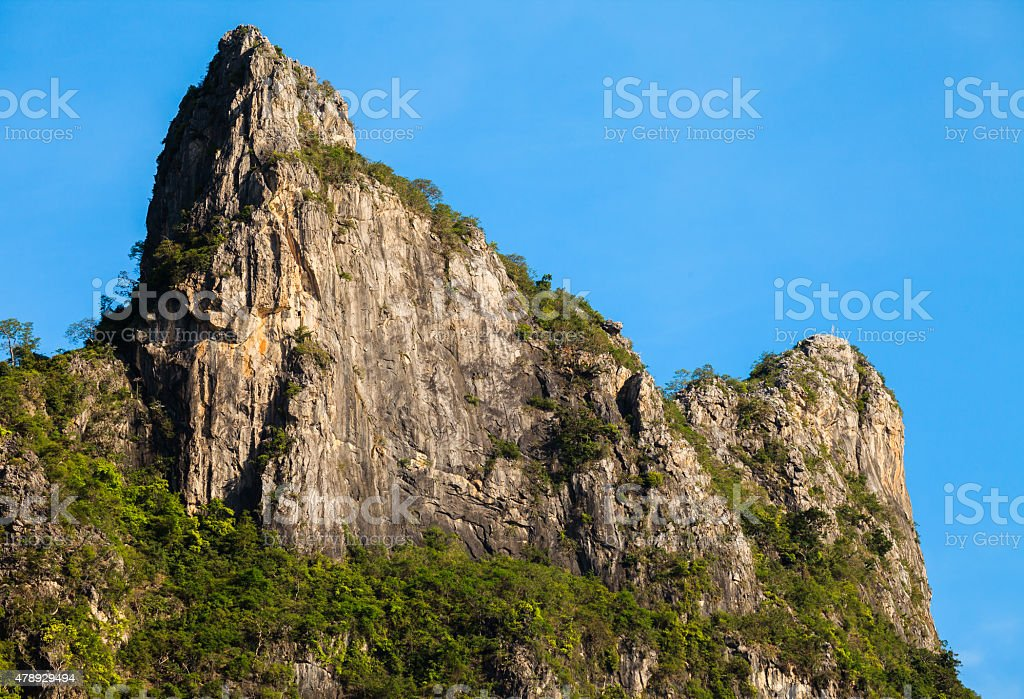 Rock mountain cliff and blue sky stock photo