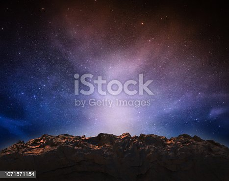 3d rendering rock mountain on space with starry sky background