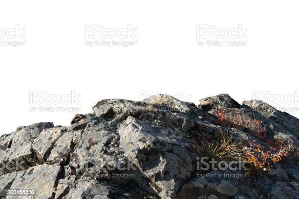 Photo of Rock mountain slope or top foreground close-up isolated on white background. Element for matte painting, copy space.