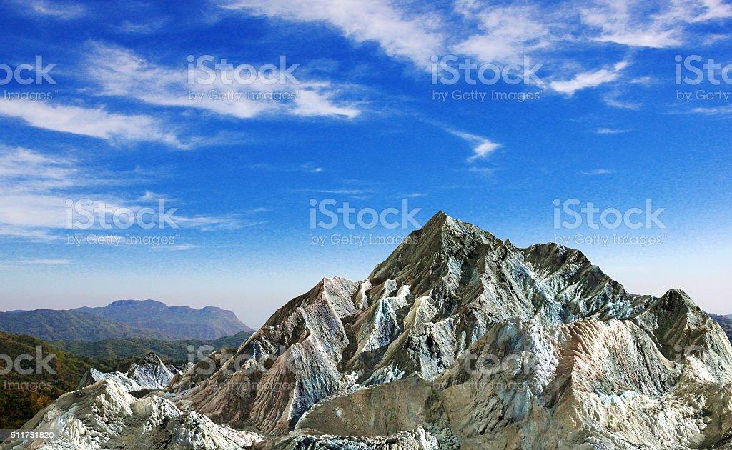 Rock mountain under cloud blue sky stock photo