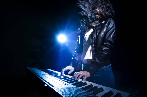 Rock musician playing keyboard on stage concept of musician on stage playng keybord keyboard player stock pictures, royalty-free photos & images