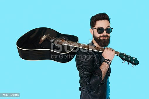 istock Rock musician posing with guitar 590168384