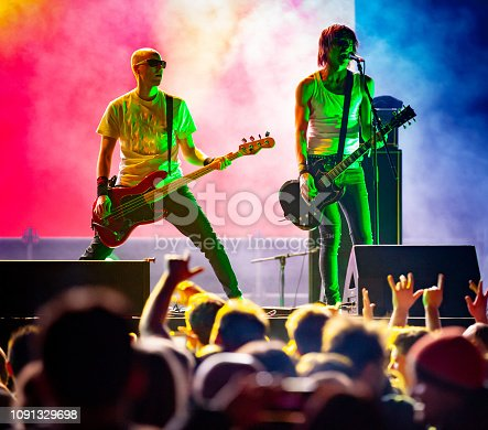 Rock Musicians Performing on Stage.