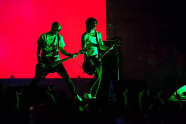 rock musicians performing on stage - punk music stock photos and pictures
