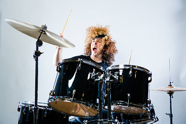Rock n Roll Drummer Rock n Roll Drummer playing the drums with passion and soul. This musician is really into what he is doing. drummer stock pictures, royalty-free photos & images