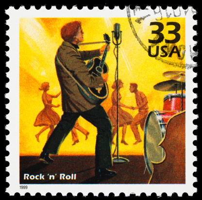 United States postage stamp with an illustration of a 1950s rock 'n' roll band with dancers in the background.