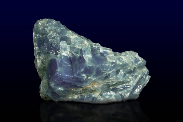Rock of blue calcite mineral on dark background stock photo