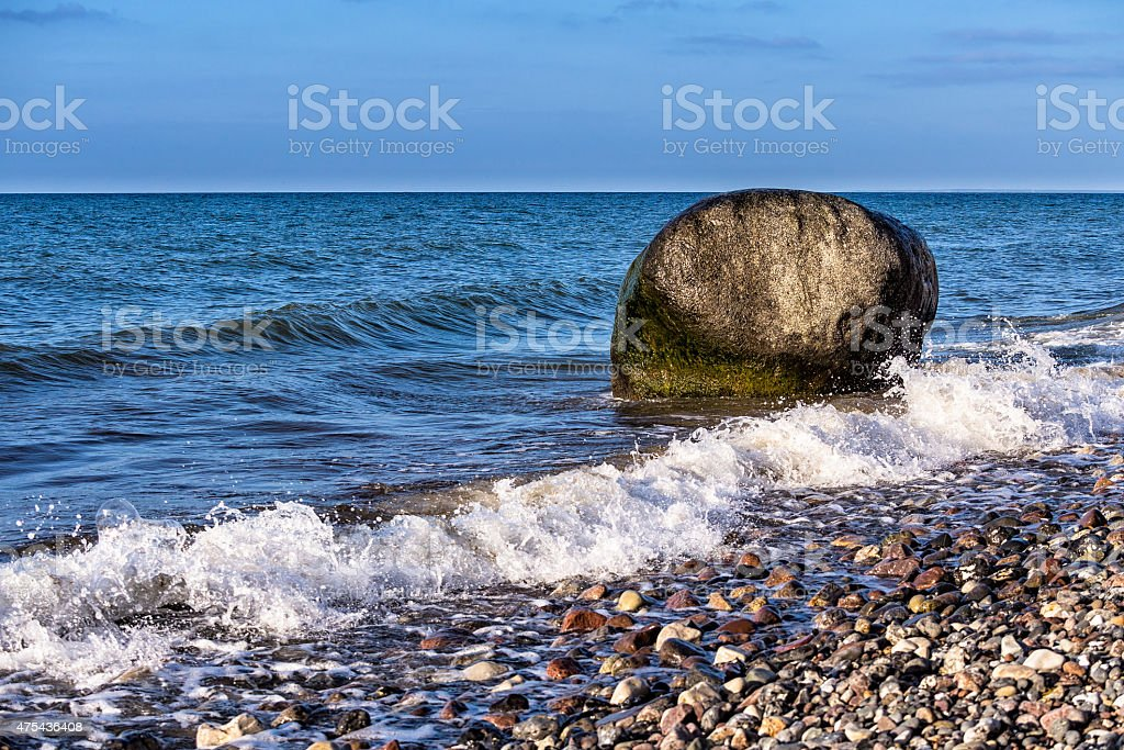Rock on shore of the Baltic Sea stock photo