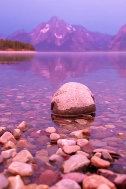 Rock on the shore line of Jackson Lake stock photo