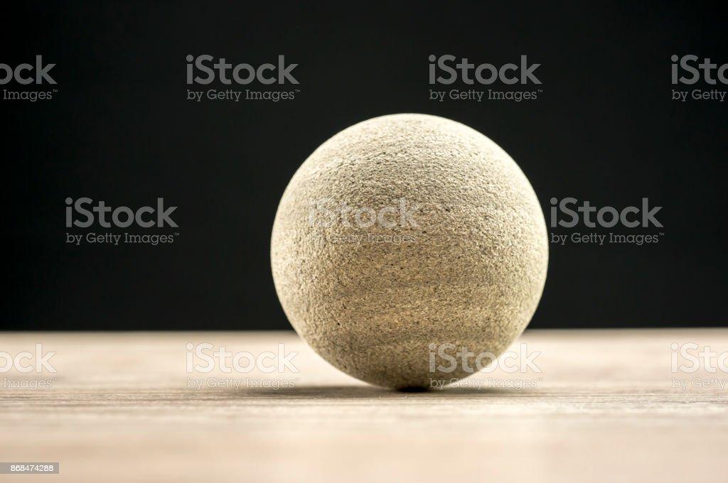 Rock on wood stock photo