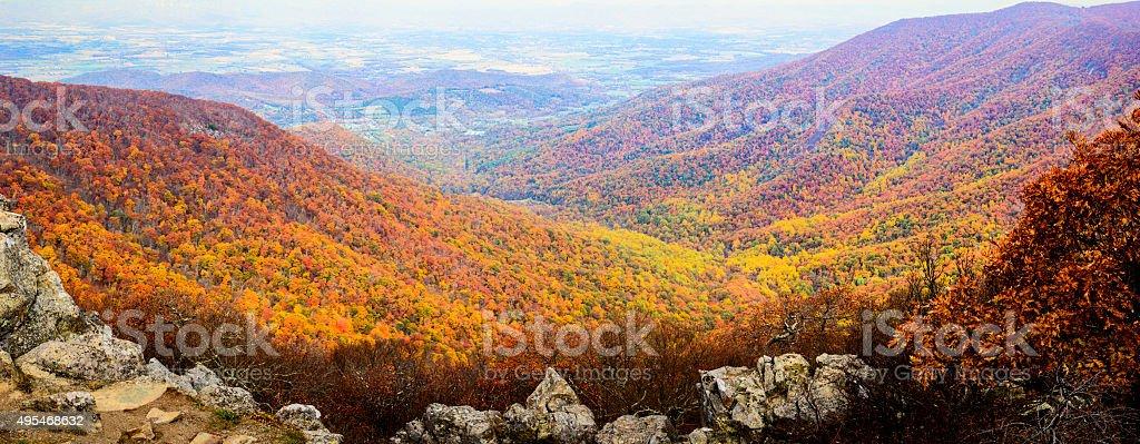 XXXL: Rock outcroppings frame the autumn forest stock photo