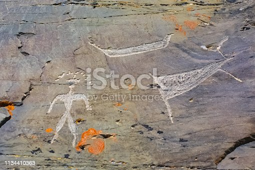 istock Rock paintings on the rocks in Chukotka. 1134410363