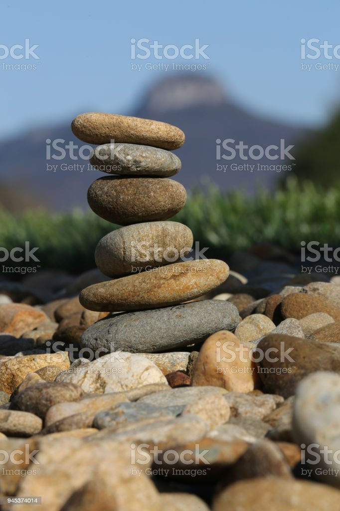 rock pile with Pilot Mountain in the back ground stock photo