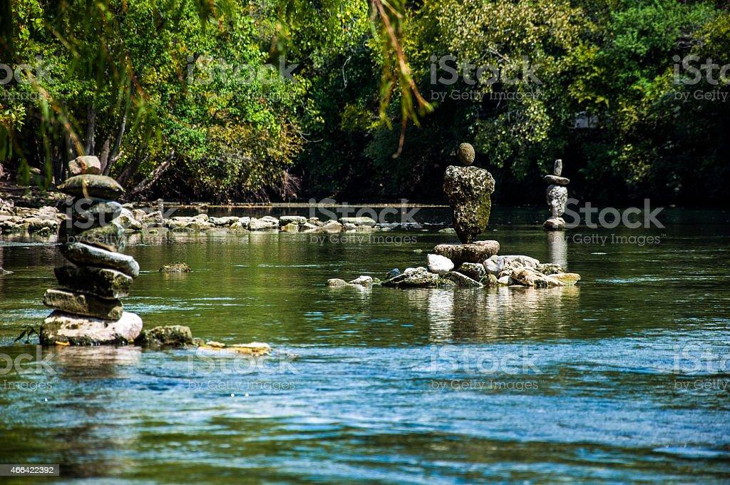 Rock Stacking near Town Lake Austin Texas stock photo