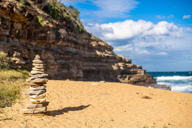 Rock Stacking on Secluded Beach stock photo