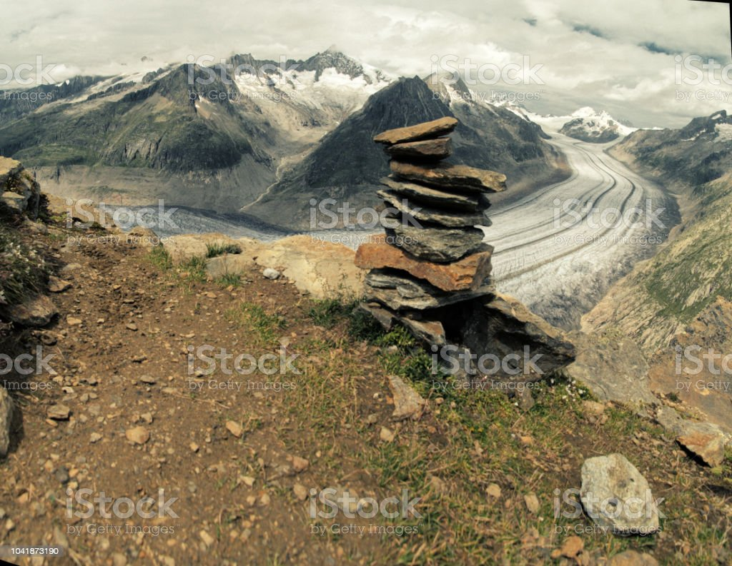 Rock stacking over the Great Aletsch Glacier stock photo