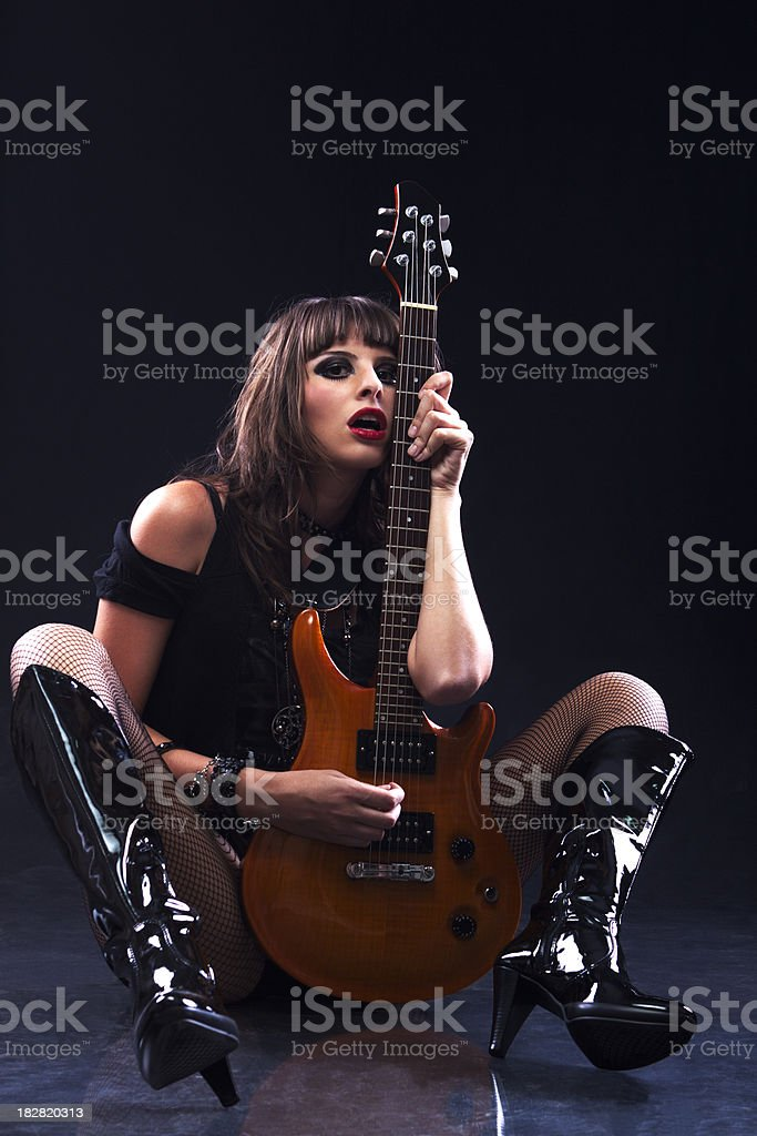Rock Star holding Guitar royalty-free stock photo